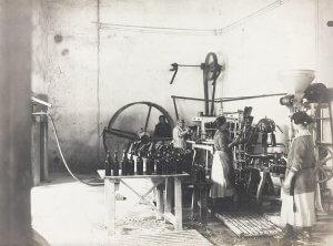 Women Bottling Wine