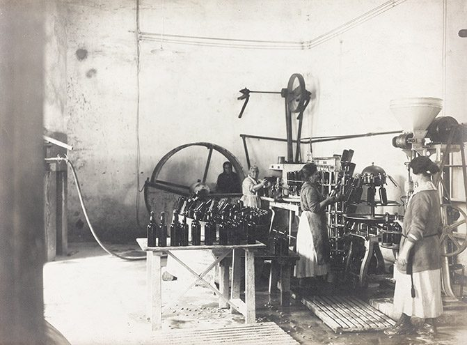Women Bottling Wine